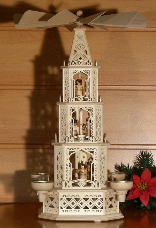 original weihnachtspyramiden aus dem erzgebirge orientalische engel pyramide mit teelichtern. Black Bedroom Furniture Sets. Home Design Ideas